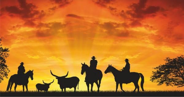Cowboys im Sonnenuntergang