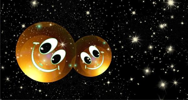 zwei Smileys im Sternenhimmel